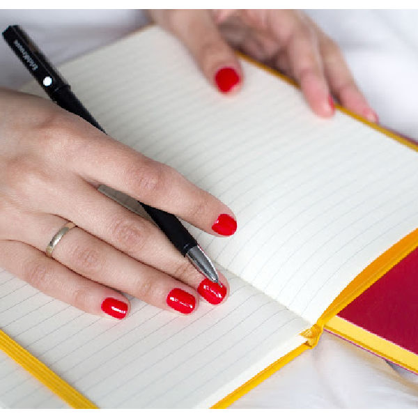 Woman writing making new goals